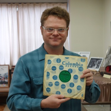 At the Suzuki Museum, holding Suzuki's copy of the 78 recording of his Twinkle Variations