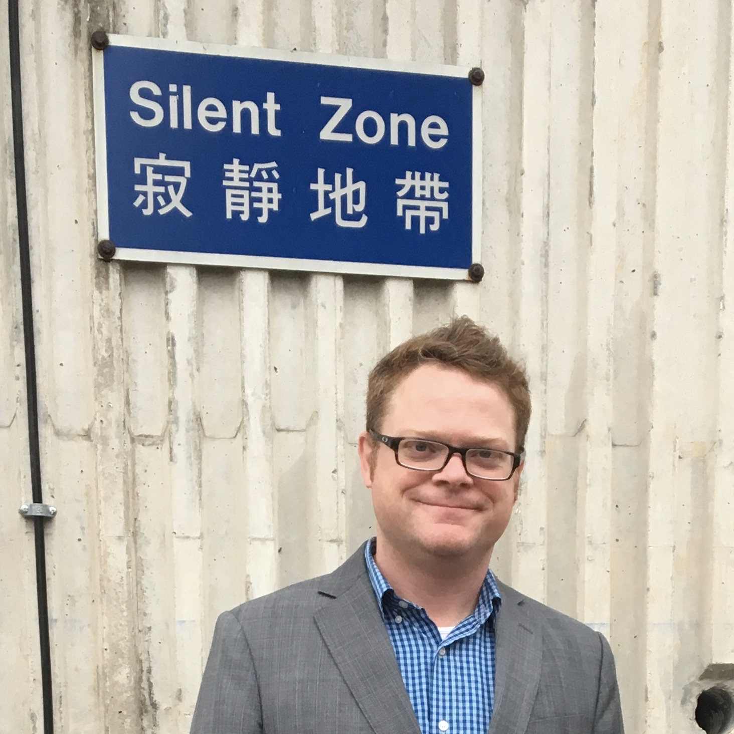 """In Hong Kong in front of """"Silent Zone"""" sign"""